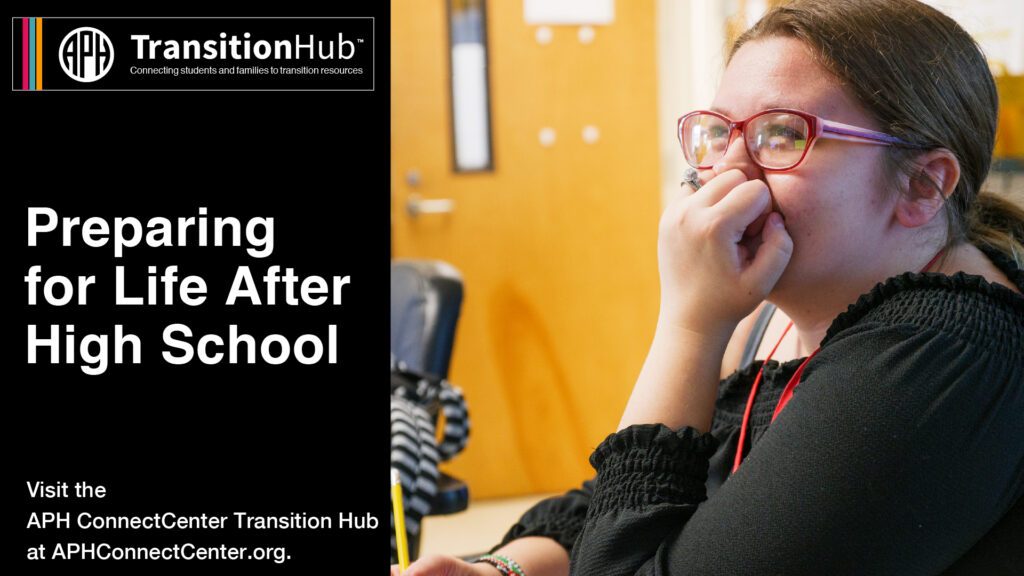 Girl sitting at desk with hand on face smiling. Preparing for life after high school.