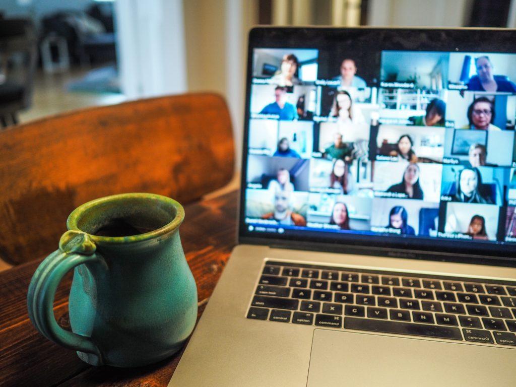 Laptop screen showing attendees at a webinar